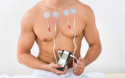 TENS therapy on man's chest
